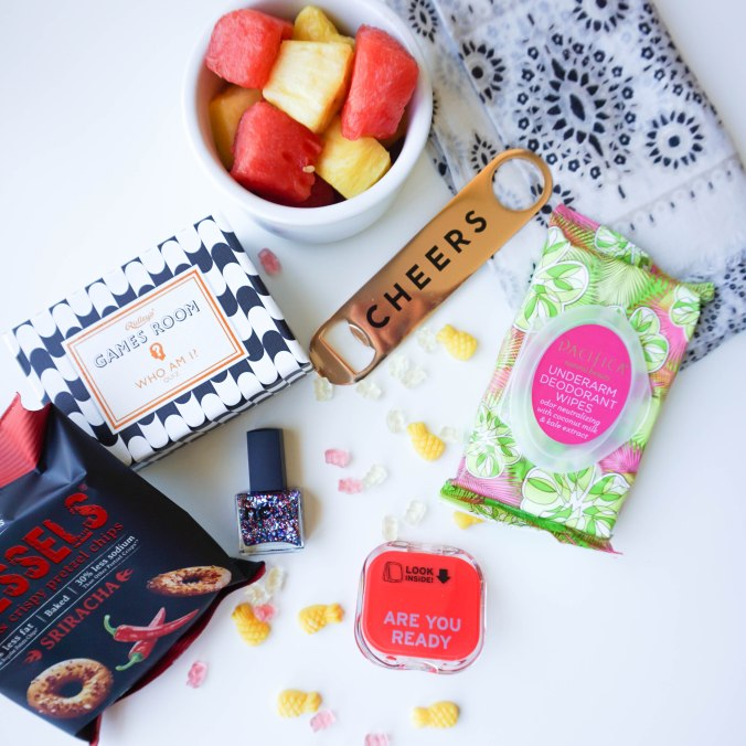 "popsugar must have box, June must have box, sriracha pretzels, watermelon, pineapple, surgarfina champagne gummy bears, sugarfina pineapple candy, hat attack sarong, black and white sarong, sisters of los angeles bottle opener, ridley's games room ""who am I?"" quiz, ncla nail polish, knock knock compact, compact mirror, pacifica deodorant wipes, Sriracha pressels"